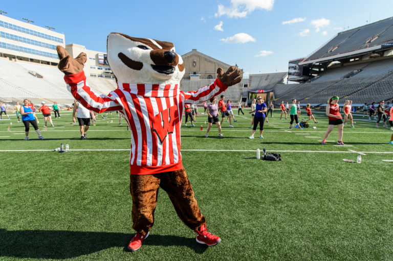 Bucky Badger works out at Camp Randall with UW students