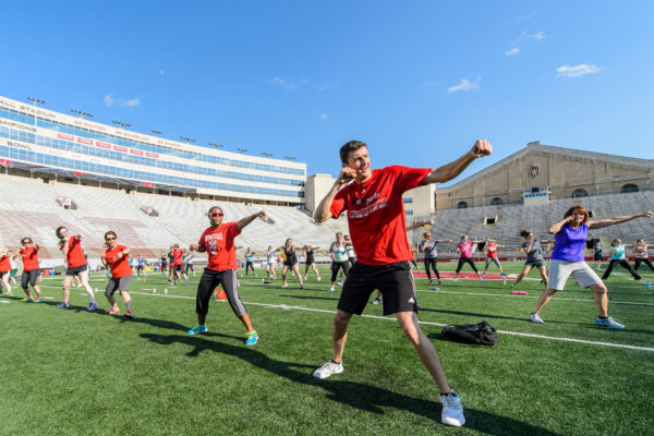 With UW mascot Bucky Badger leading them, members of the UW-Madison community participate in Bucky's Workout, a collaborative event hosted by UW Athletics, Rec Sport, Human Resources and UWell at Camp Randall Stadium