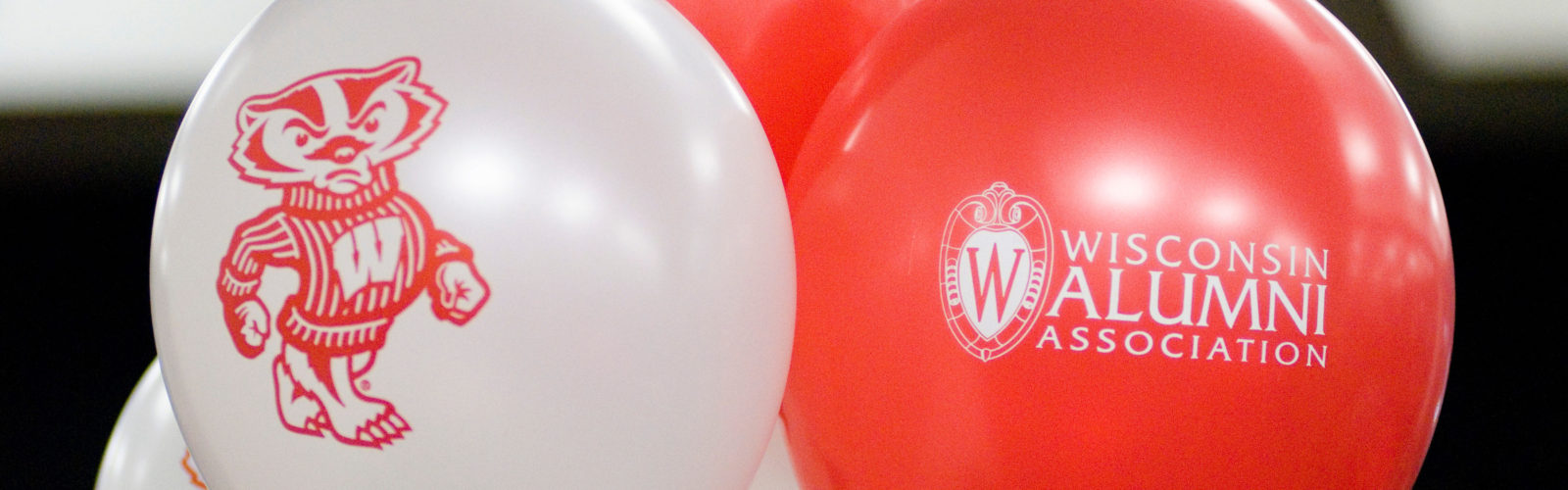 Bucky Badger balloon and Wisconsin Alumni Association balloon